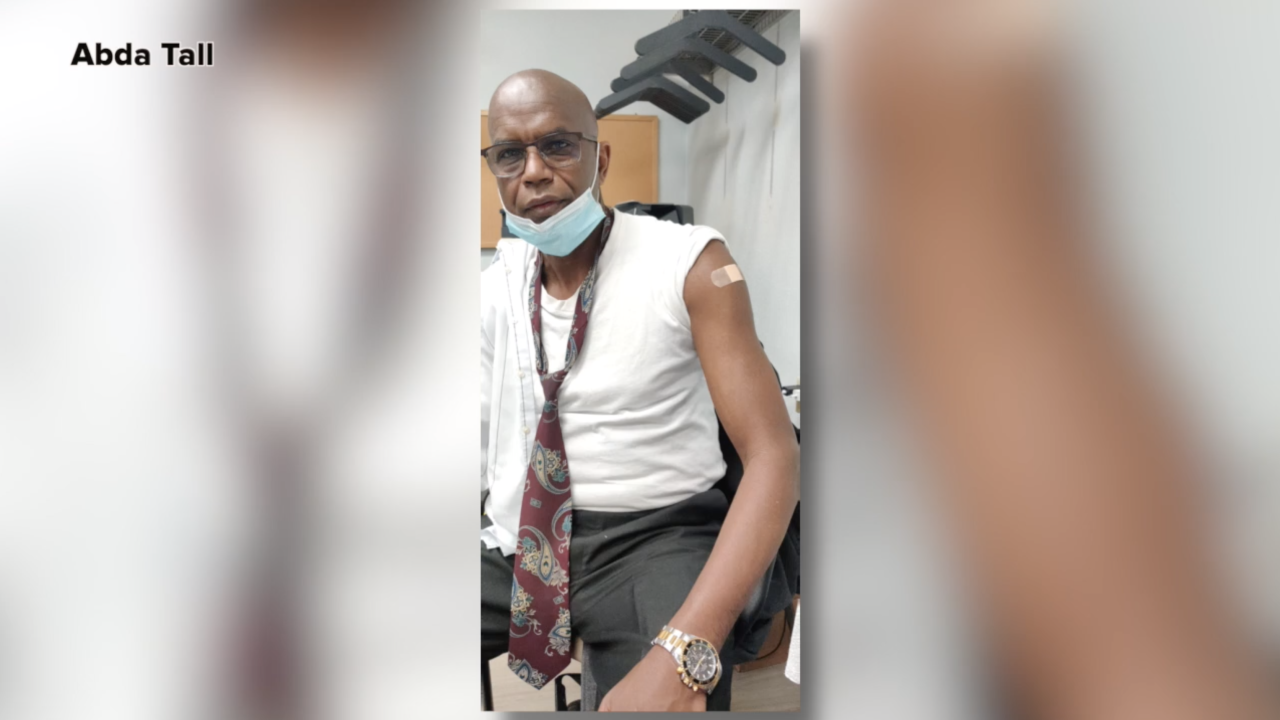 Medical interpreter Abda Tall, pictured in this provided photo after receiving a COVID-19 vaccination shot, is using social media to dispel misinformation about the virus circulating through Cincinnati's African communities.