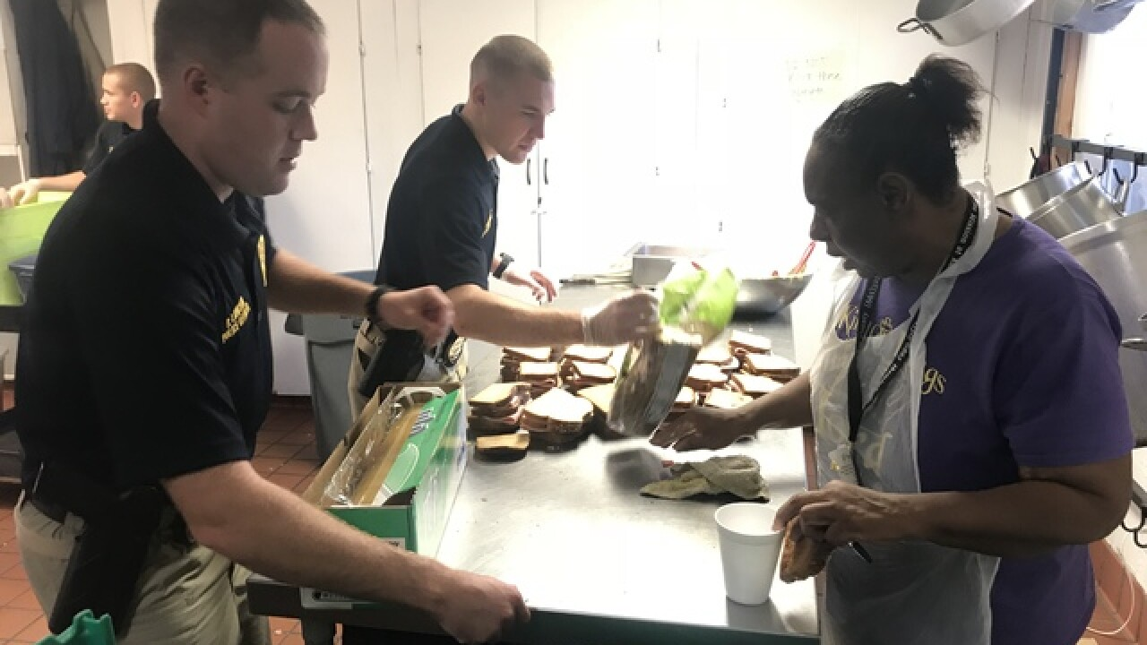 Newly sworn officers feed the homeless