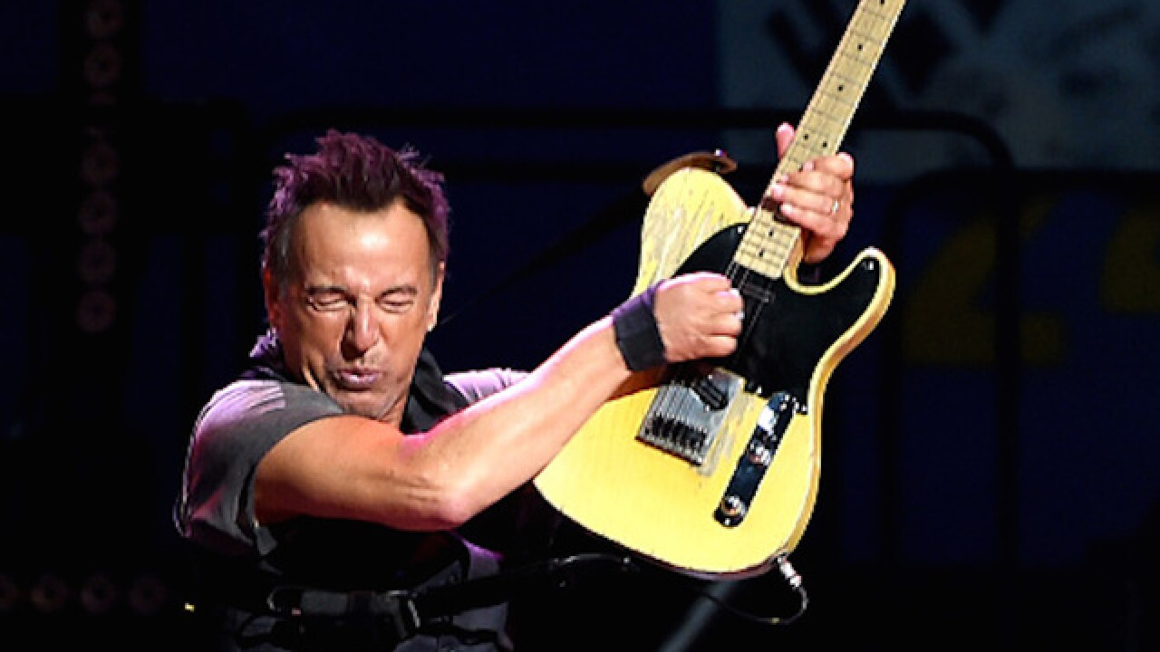 Bruce Springsteen signs tardy slip for young fan