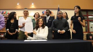 Governor Whitmer Signing a new K-12 funding Bill