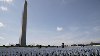"""More than 660,000 flags have been planted on the National Mall in Washington, D.C.: one for each life lost in America to COVID-19. The art installation is called """"In America: Remember."""""""