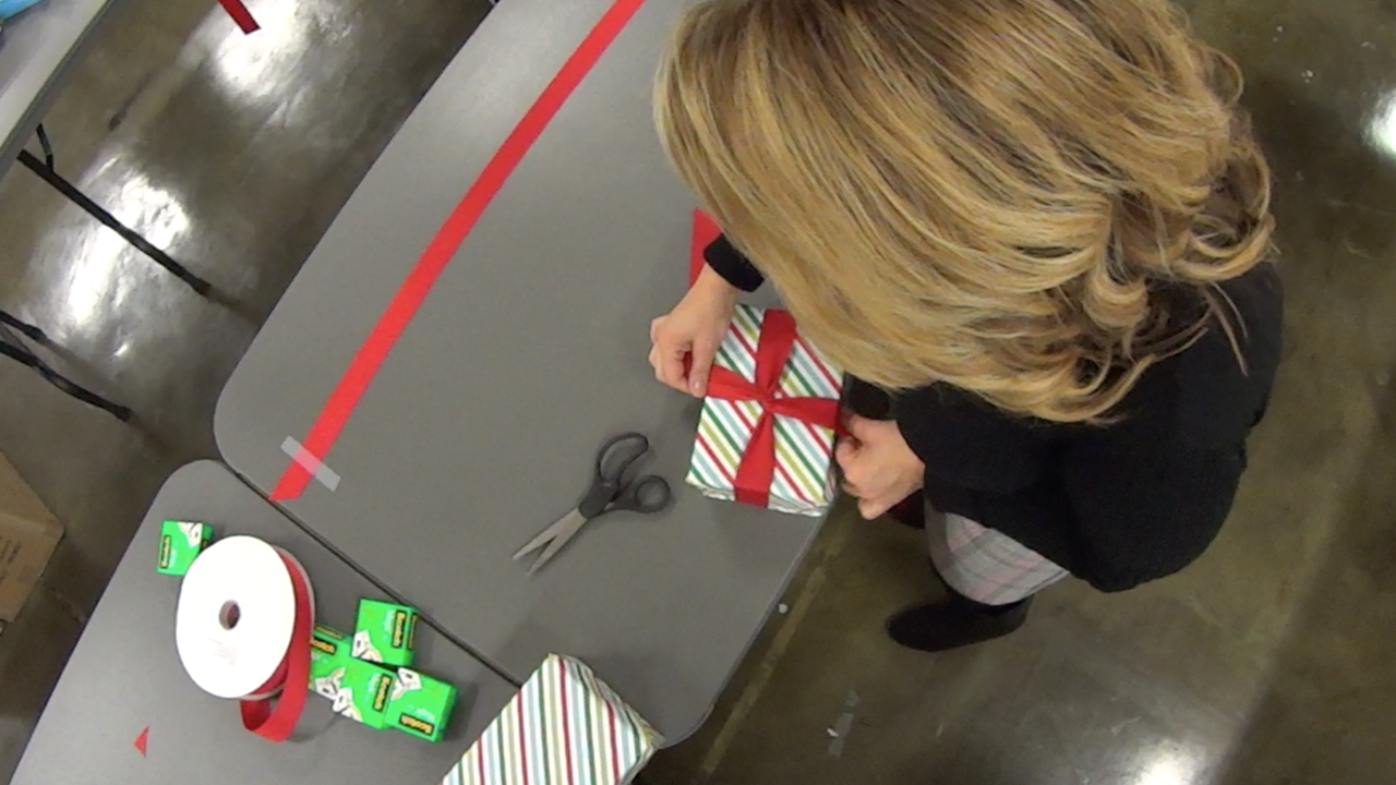 Hallmark Prison Toy lift gift wrapping 2.png