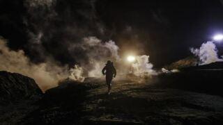 AP border migrants tear gas night.JPG