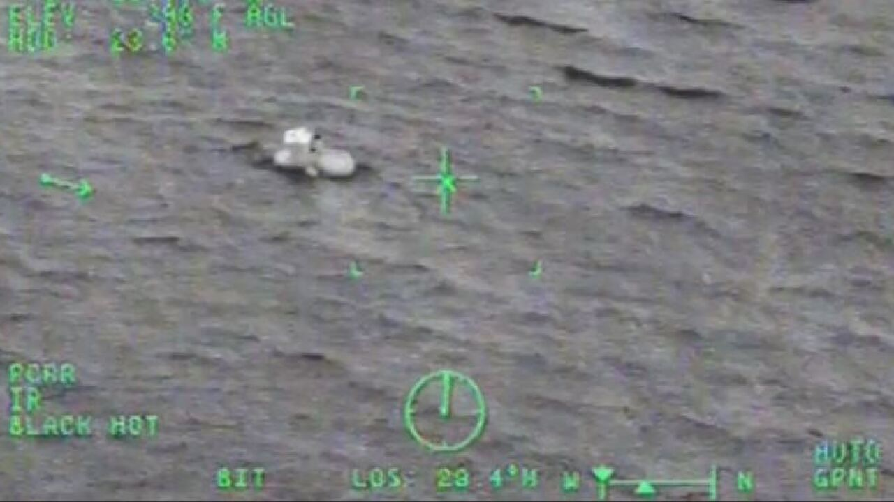 Coast Guard rescues father and daughter aboard tugboat taking on water