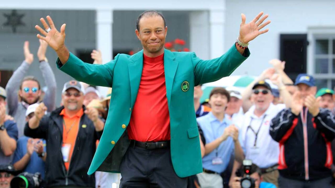 Tiger Woods of the United States waves to the patrons during the Green Jacket presentation after his historic one shot win during the final round of the 2019 Masters Tournament at Augusta National Golf Club on April 14, 2019 in Augusta, Georgia.