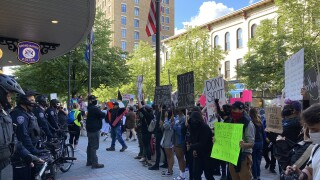 Black-Lives-Matter-Protest-riot-May-30-2020-protesters-sign-holders-stand-before-police-officers-at-GRPD-headquarters