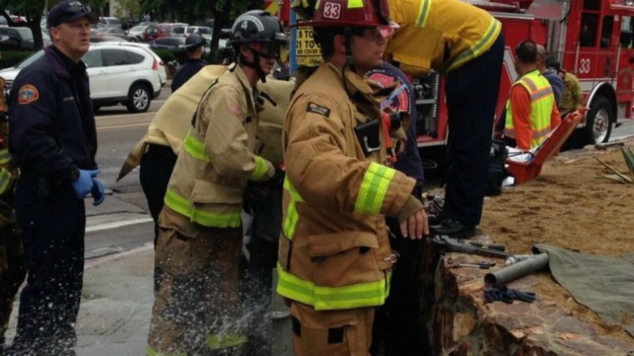Man gets hand stuck in water pipe