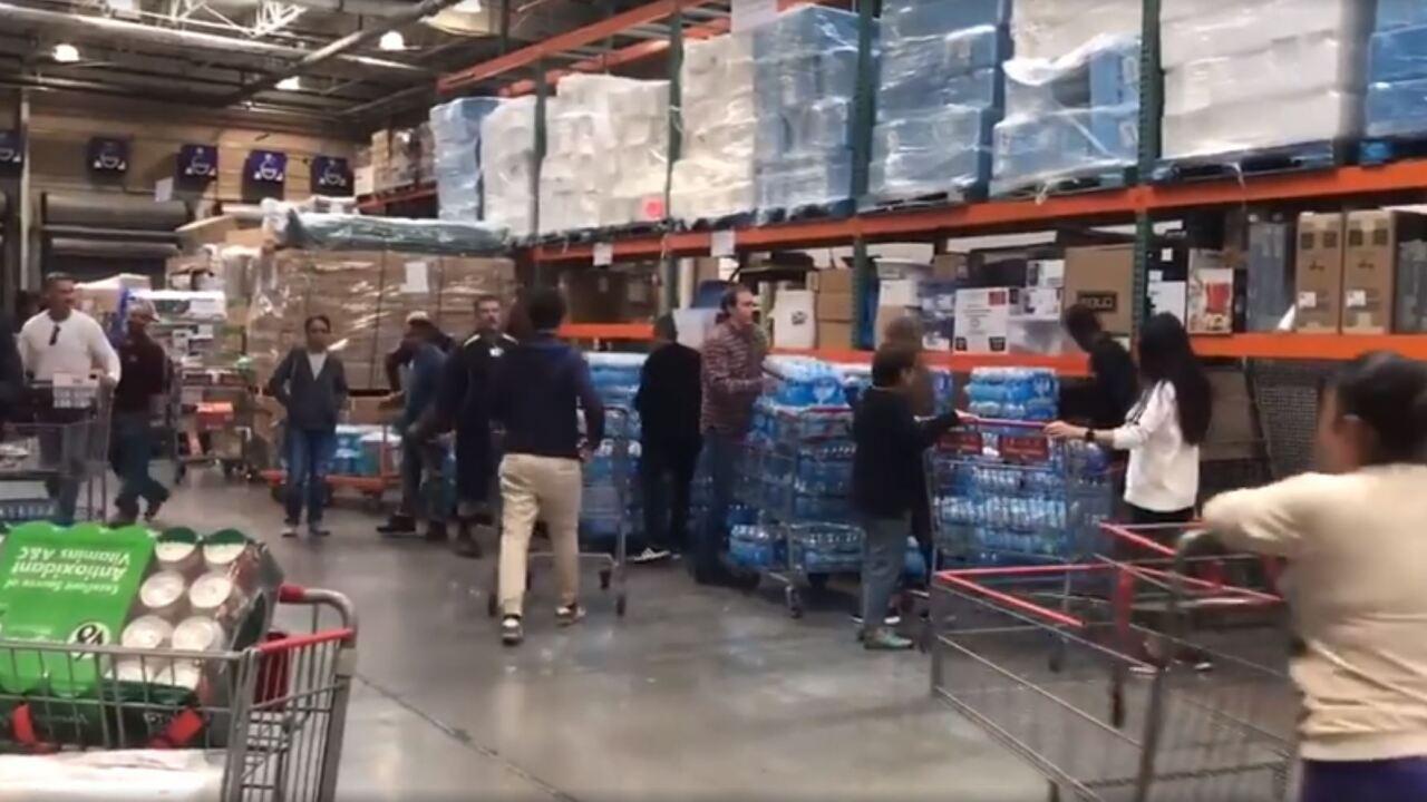 People are hitting stores to buy supplies in preparation for the coronavirus, but authorities say stockpiling bottled water and paper products will not prevent the spread of the virus