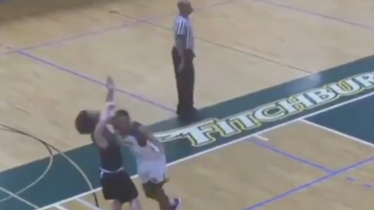 Basketball player sorry after being caught on video elbowing opponent in face