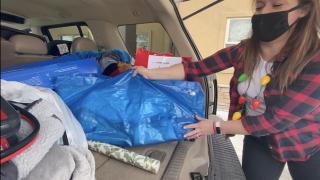 Loading presents into car at Hope House Colorado