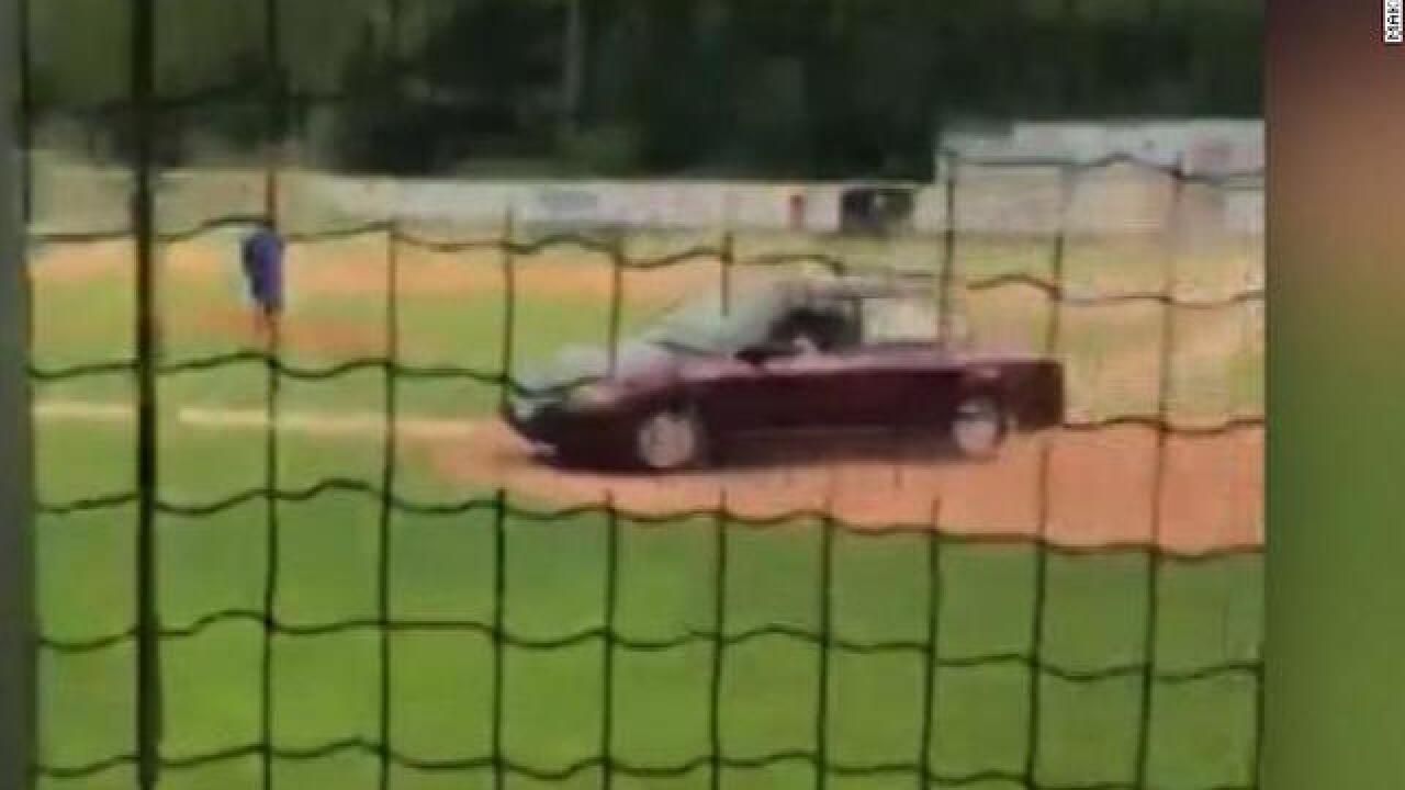 Woman charged after driving onto Maine baseball field, killing one