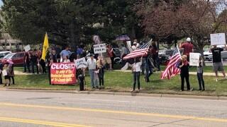 Protesters line street near Tri-County Health HQ