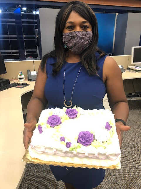 Tania Rogers holding cake, May 19, 2021