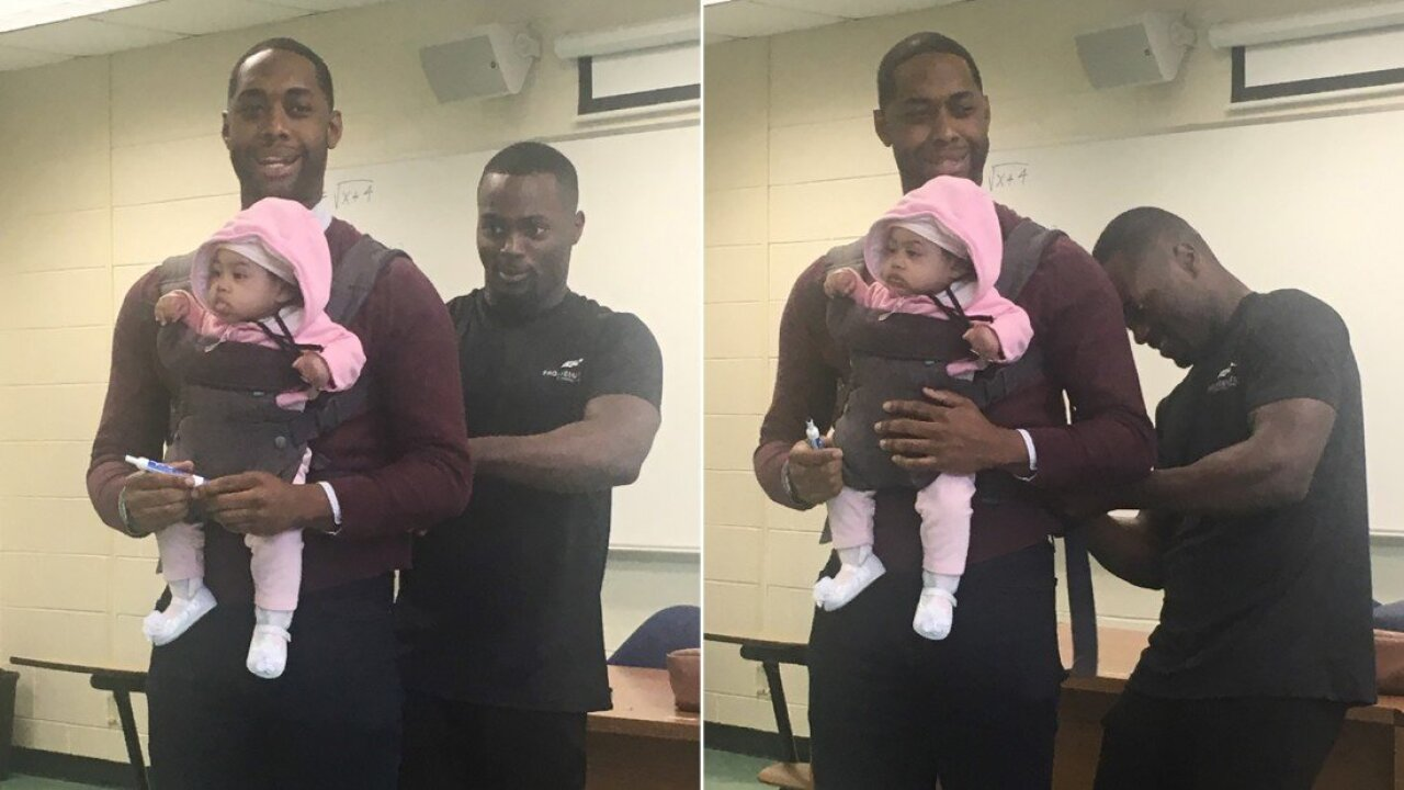 When his student couldn't find a babysitter, this professor held his baby girl so he could take notes