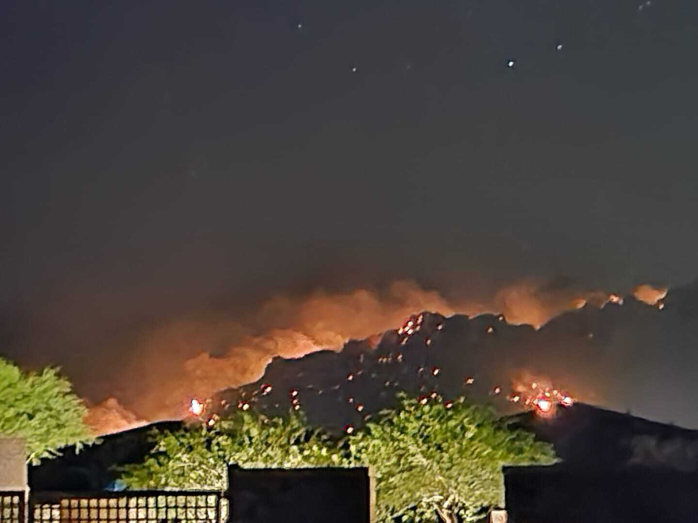 The Bighorn Fire in the Catalina Mountains as seen from the Rancho Vistoso area of Oro Valley