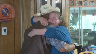 Debbie Hulme hugging Dave Horner, owner of Horner Homes