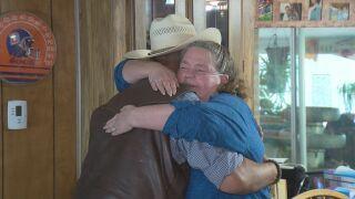 Debbie Hulme hugging Dave Horner, owner of Horner Homes