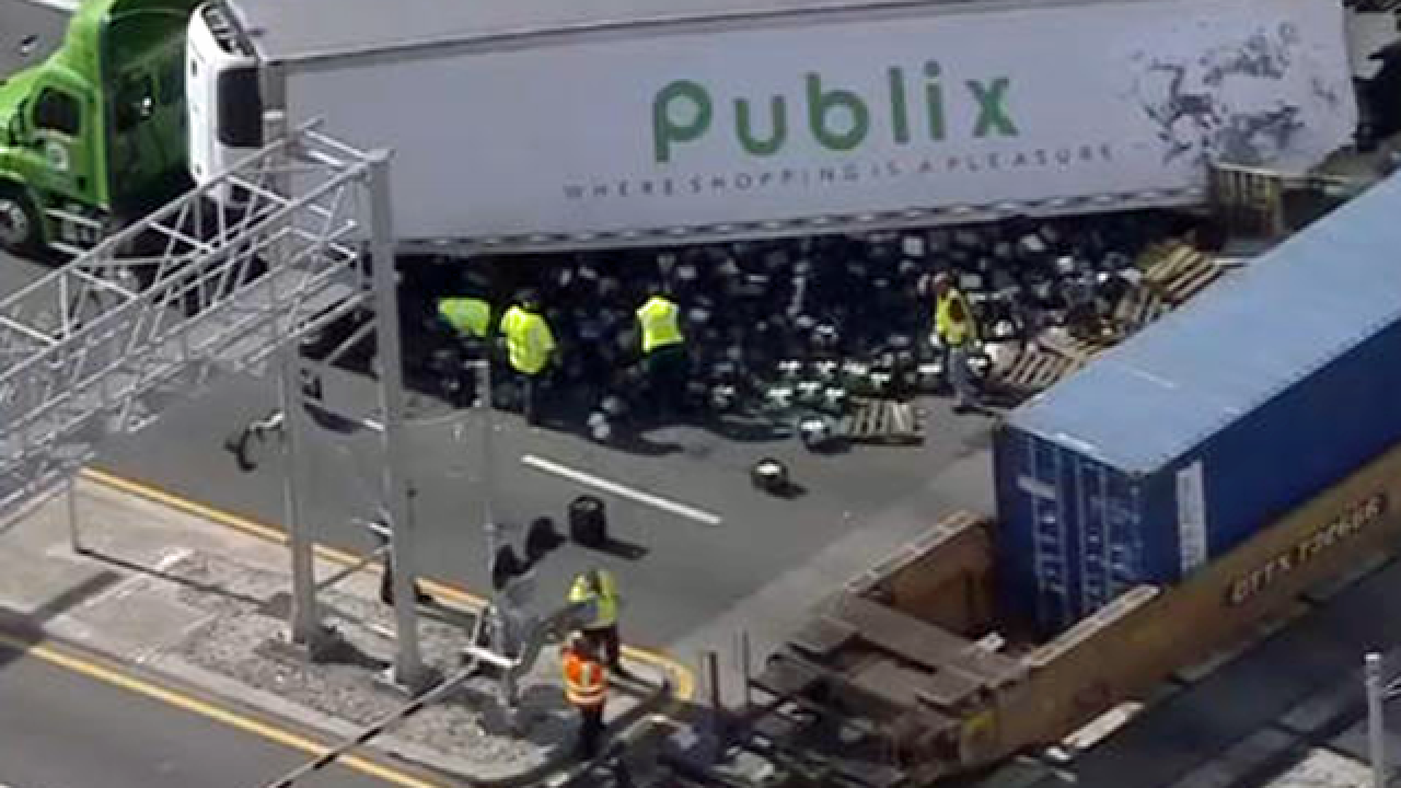 Train hits Publix truck in Deerfield Beach, groceries spilled and road closed
