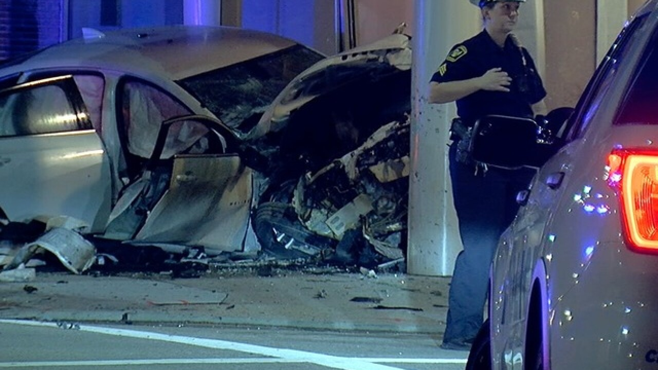 Car hits Downtown building after 2-state chase