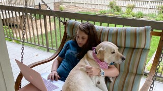 Hadley in virtual class with dog Willow .jpg