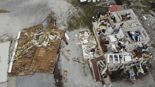 Two dead, thousands still without power as Sally continues to dump rain on southeastern US