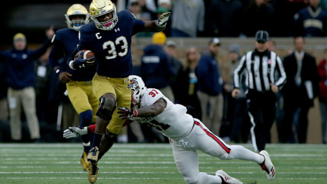 No. 9 Notre Dame wears down No. 14 behind Adams and Love