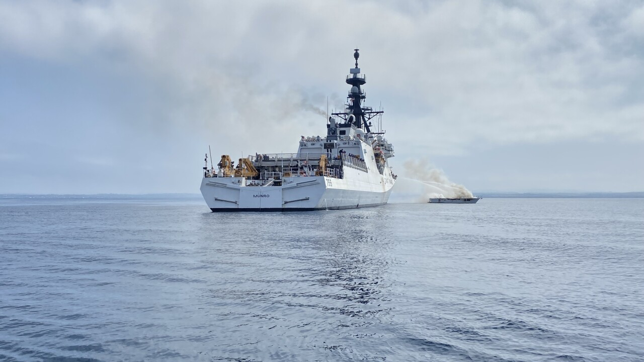 Coast Guard Cutter Munro crewmembers work to extinguish a vessel fire off the San Diego coast