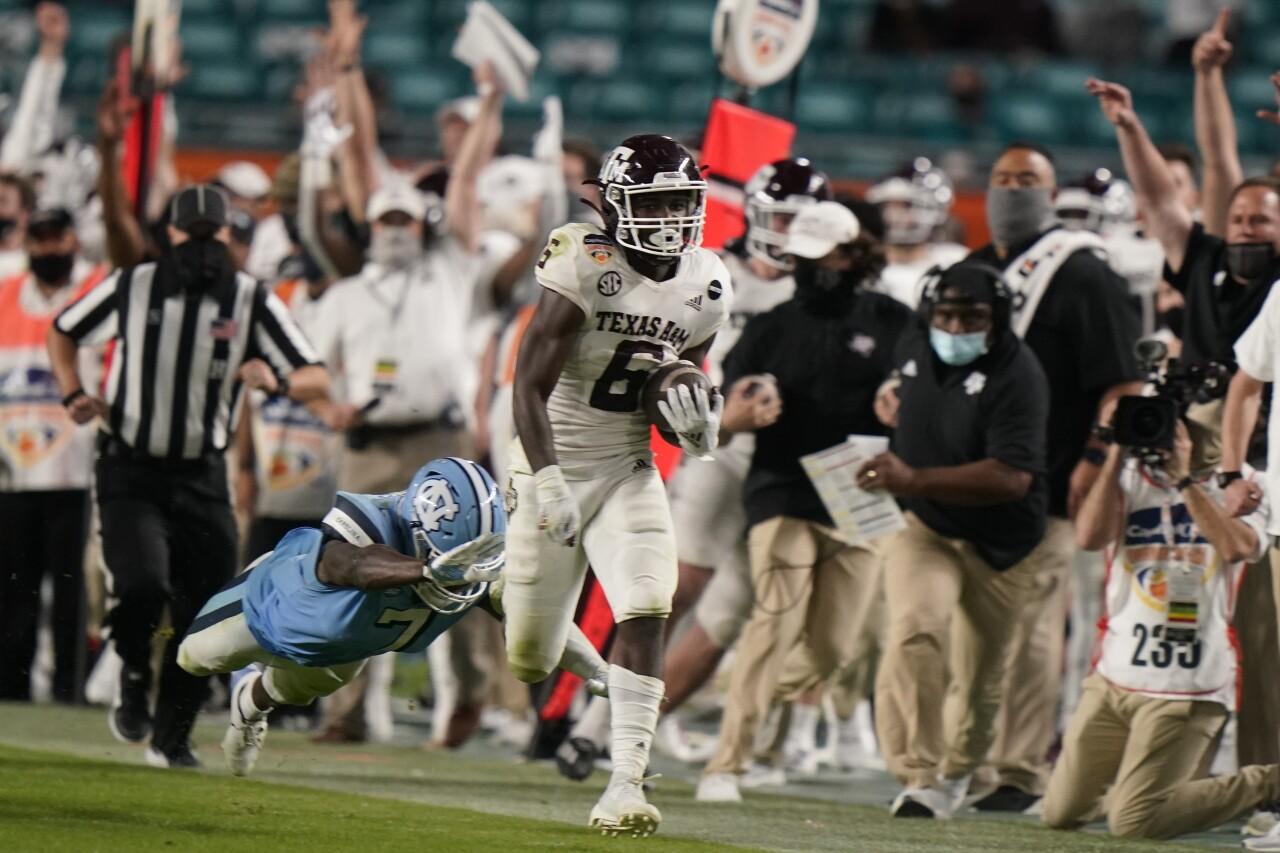 Texas A&M Aggies running back Devon Achane runs for TD vs. North Carolina Tar Heels in Orange Bowl