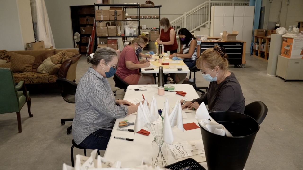 Volunteers spent weeks carefully writing out dedications to those lost to COVID-19 onto the white flags. The dedications were submitted from across the country, via a website related to the art installation.
