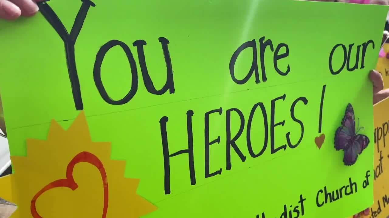 'You are our heroes!' sign made by church group outside Lawnwood Regional Medical Center