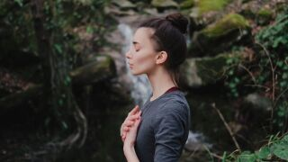 picture of woman by waterfall deep breathing_640x360.jpg