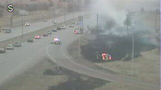 Grass fire at Powers Blvd and Platte Ave
