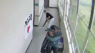 Coach hugs student.PNG
