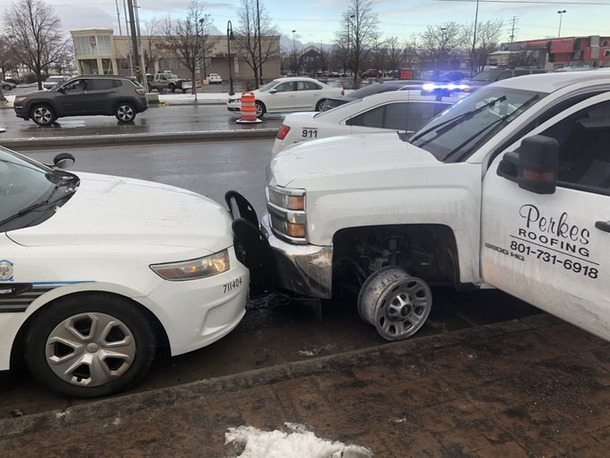 Photos: Suspected stolen truck hits at least two police cars before coming to a stop