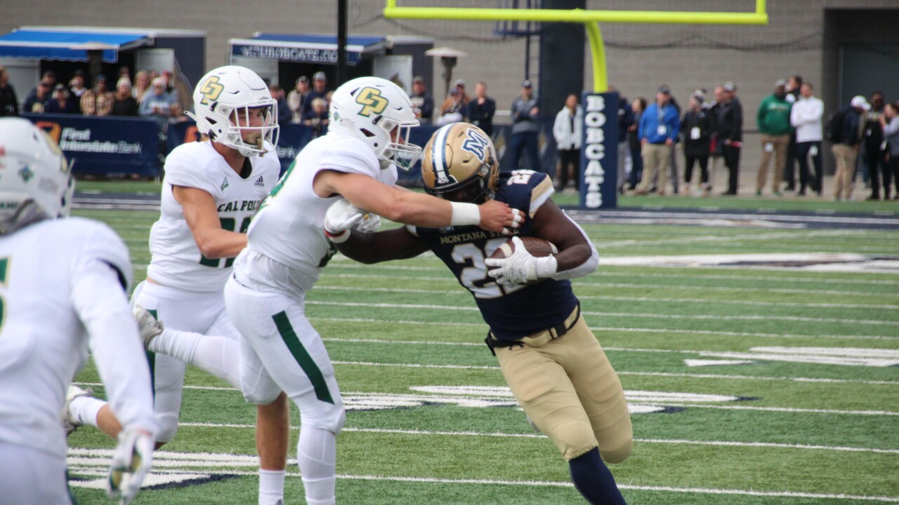 RB Isaiah Ifanse breaks a tackle in the first half
