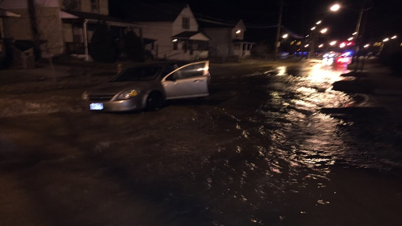 Woman drives car into broken water main in CLE