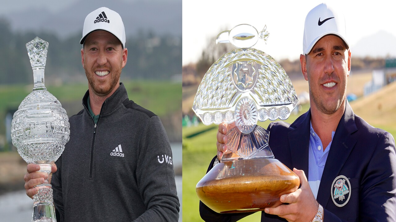 Daniel Berger and Brooks Koepka holding February 2021 PGA Tour trophies