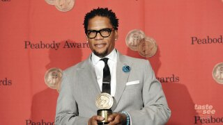 Writer, actor and producer D.L. Hughley poses with his award at the 72nd Annual George Foster Peabody Awards at the Waldorf-Astoria on Monday, May 20, 2013 in New York. (Photo by Evan Agostini/Invision/AP)