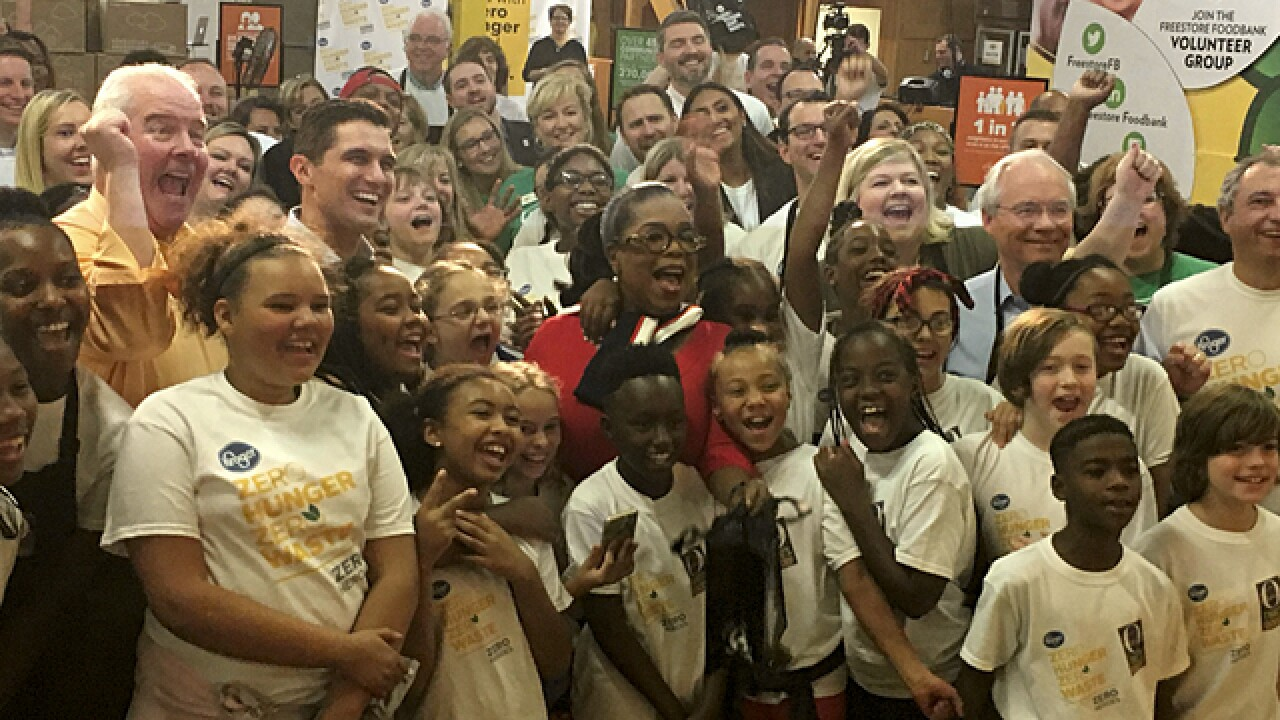 Oprah Winfrey helps Freestore Foodbank volunteers make meals for Cincinnati school kids