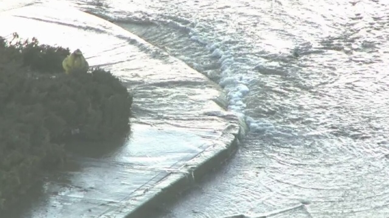 Water gushes from hydrant at Buckley & Iliff