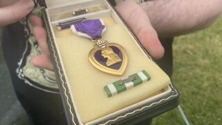 Purple Heart awarded to West Michigan veteran reunited with family
