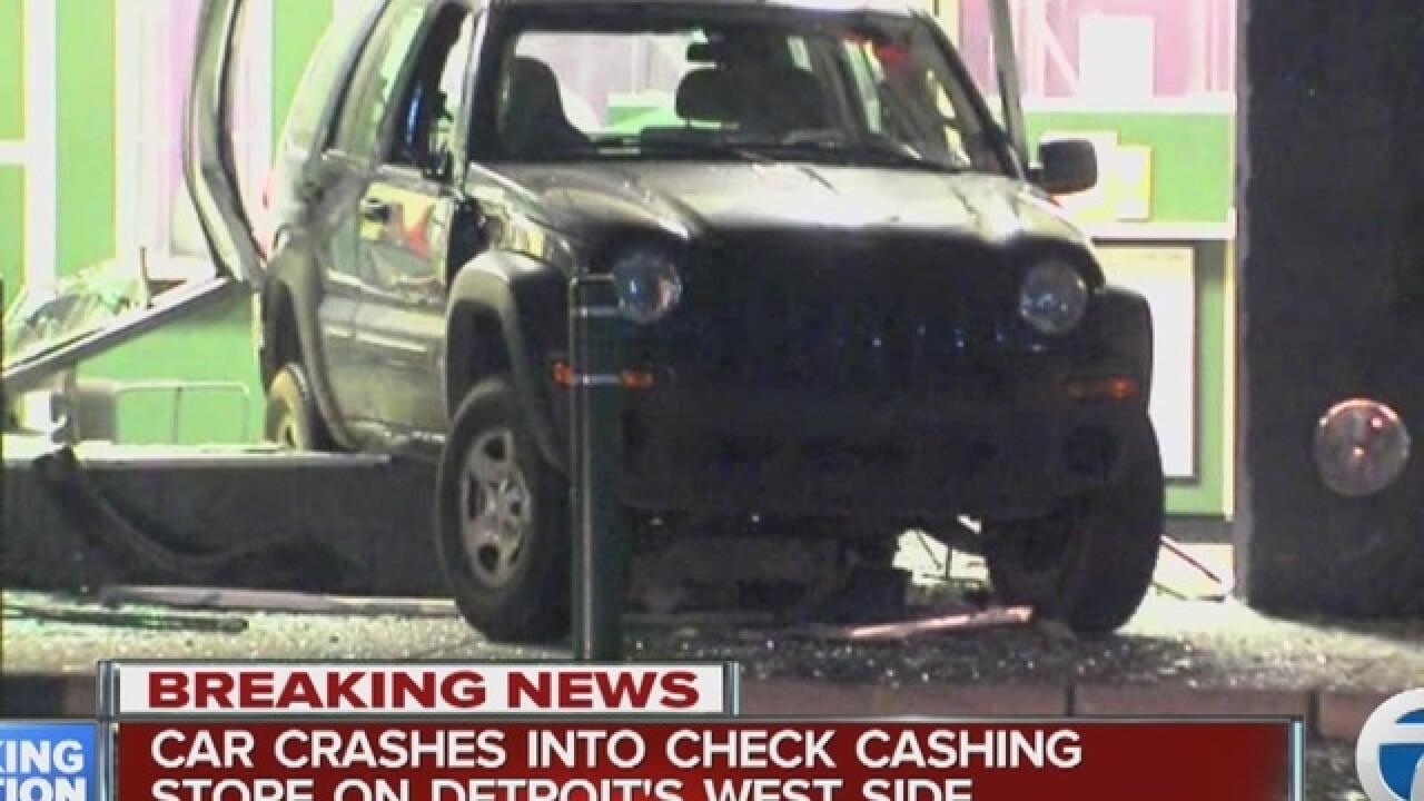 Vehicle crashes into check cashing store