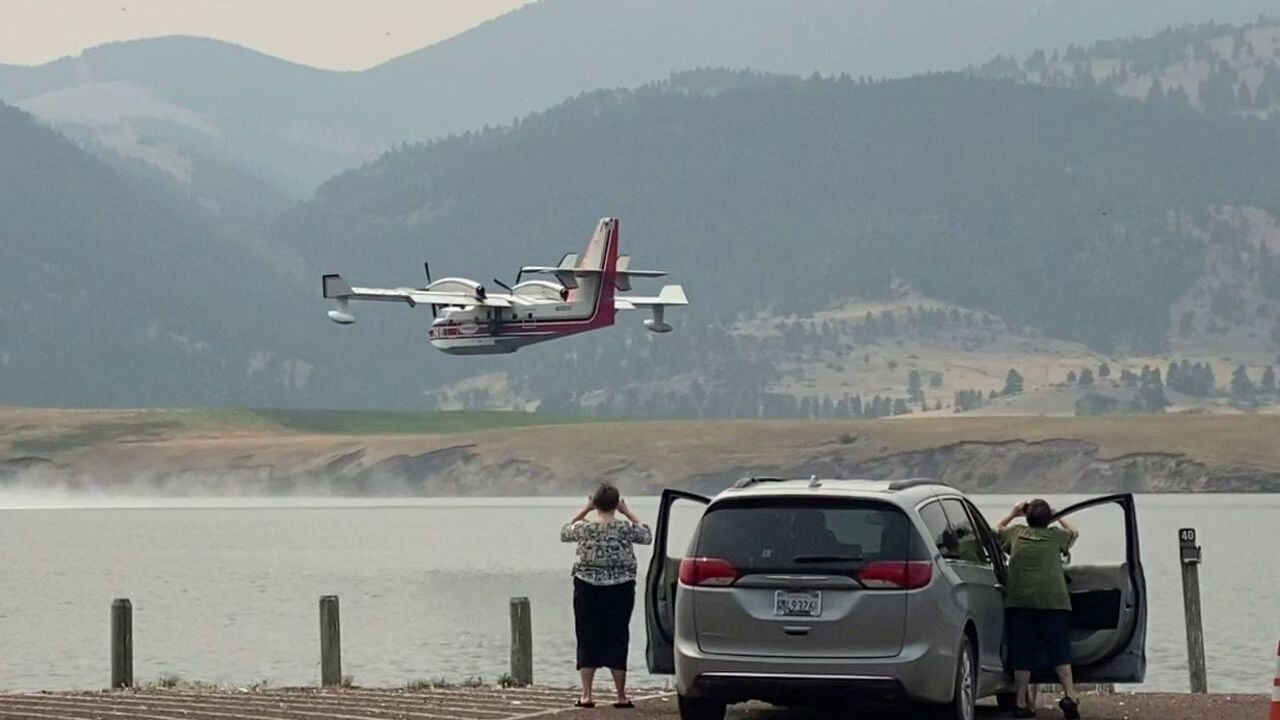 """Scooper"" plane skims Holter Lake"