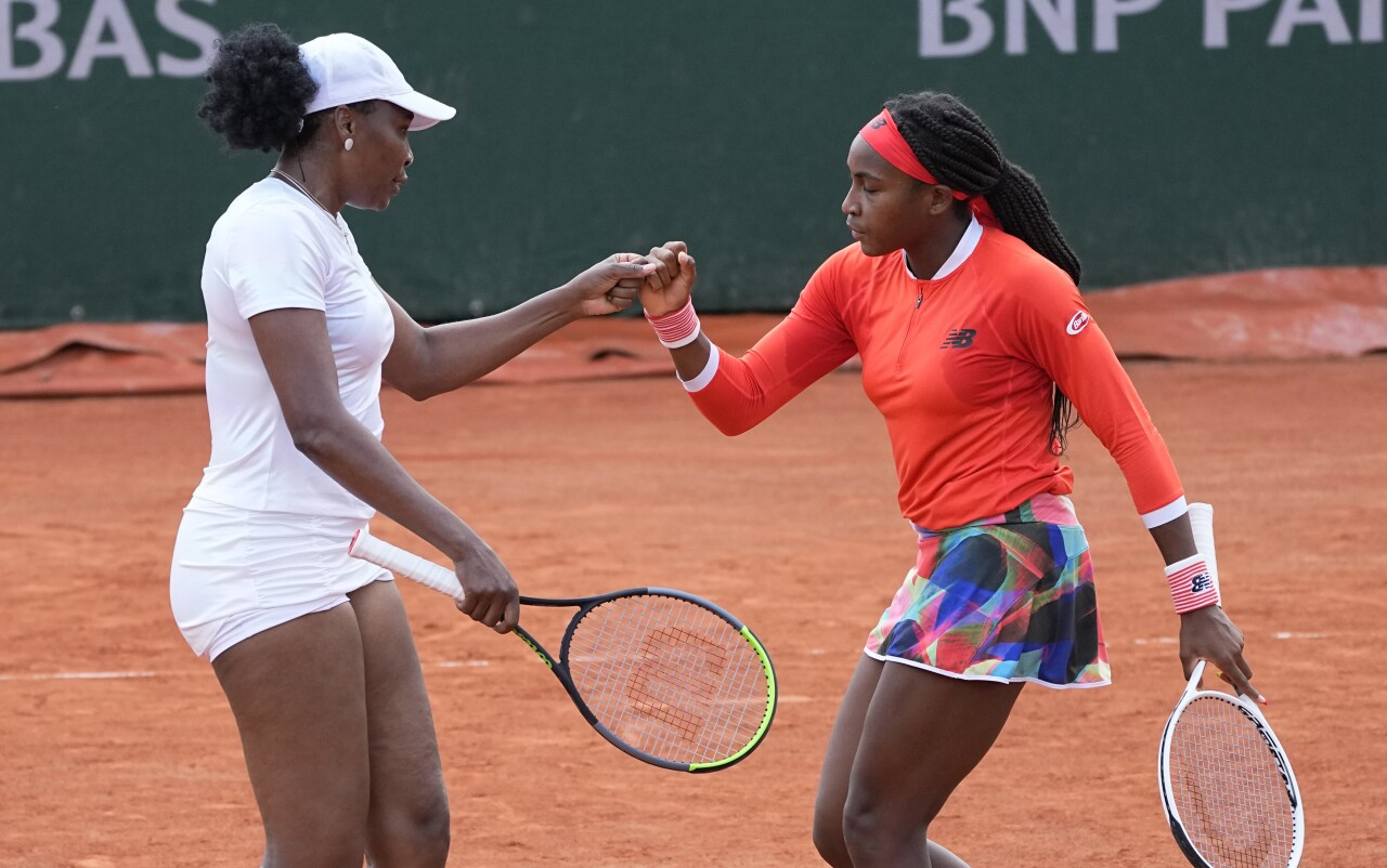 Venus Williams and Coco Gauff bump fists during French Open doubles appearance, June 2, 2021