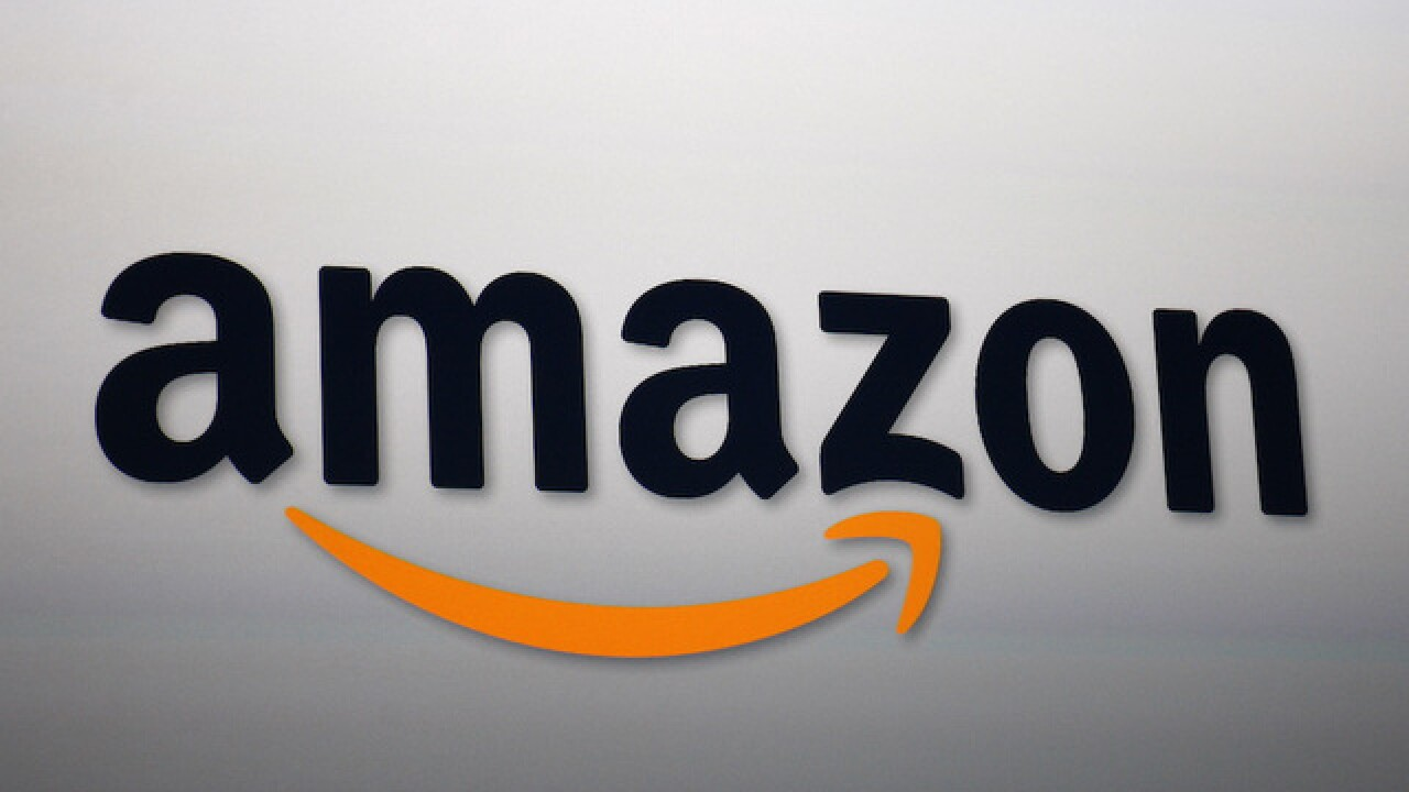 Amazon stock tops $1,000