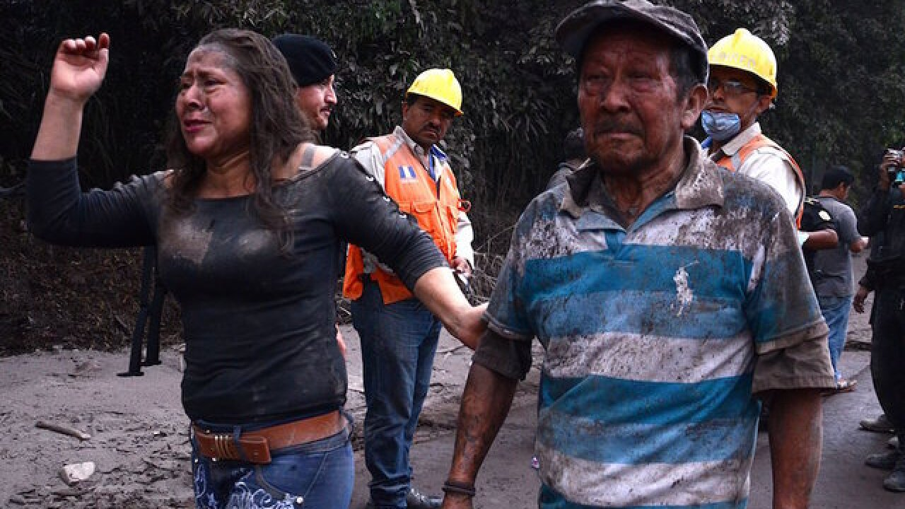 Entire families buried as Guatemalans battle to recover the dead after volcano eruption