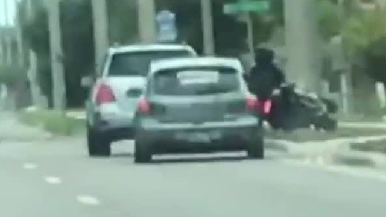 Driver intentionally rams motorcyclist off road