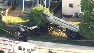 Semi crash into backyard_June 7 2021