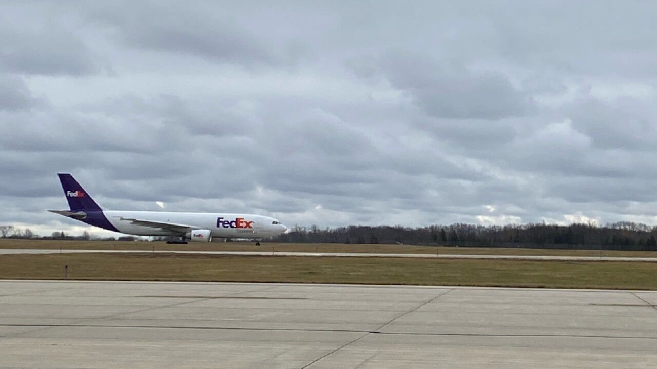 FedEx plane carrying Pfizer COVID-19 vaccine from Portage plant takes off at Gerald R. Ford International Airport December 13, 2020