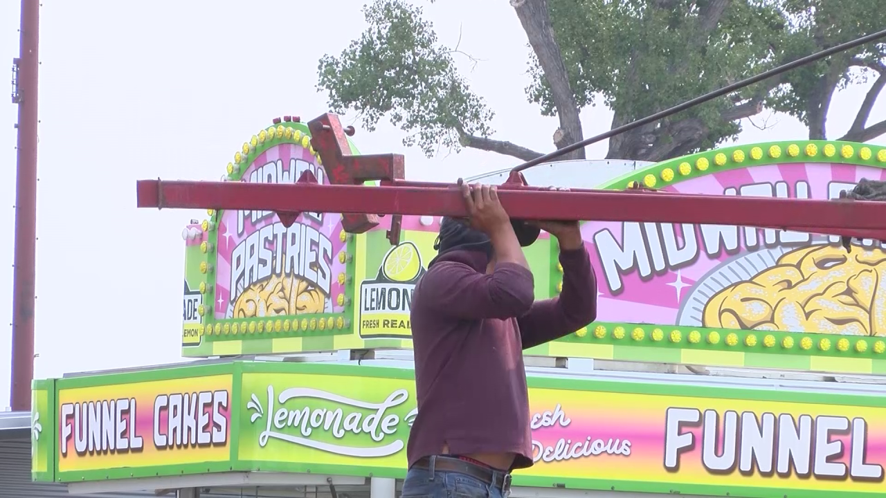 Carnival workers set up for Montana State Fair
